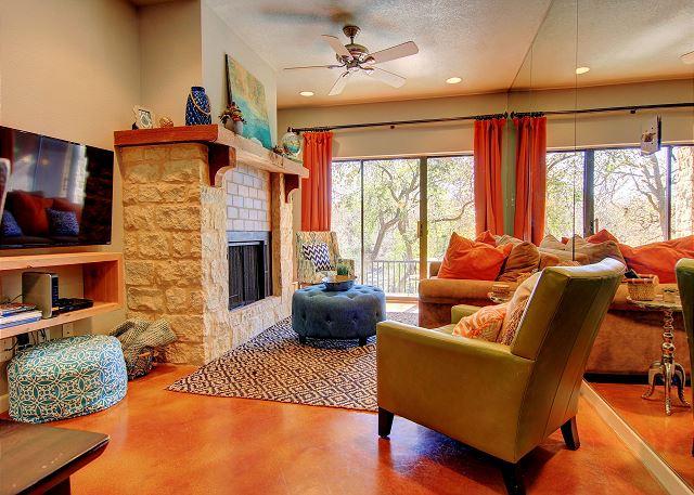Camp Warnecke condo living room with fireplace.